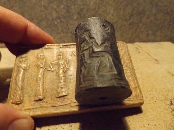 Sumerian cylinder seal of Ur Nammu. Museum replica tablet set. Mesopotamian art.