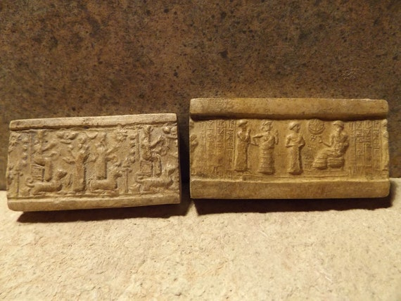 Sumerian and Assyrian cylinder seal impressions x 2 - Ur Nammu and Ishtar. Mesopotamia
