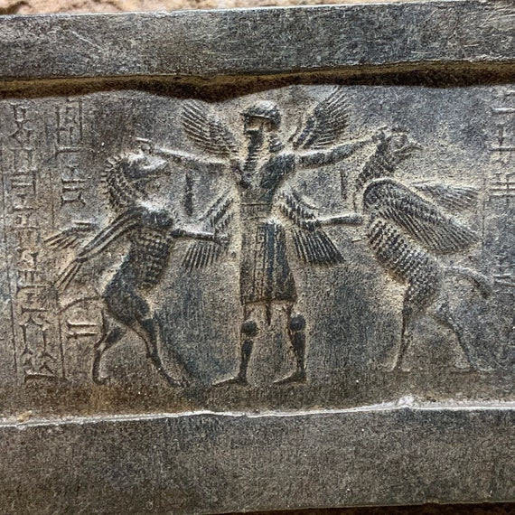 Mesopotamia Assyrian cylinder seal impression - Annunaki / Apkallu / Hero wrestling winged griffins
