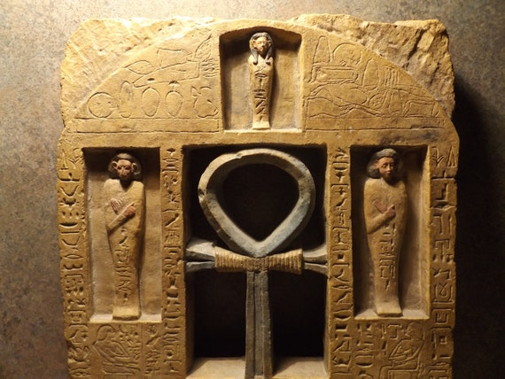 Egyptian art / sculpture / shrine stele featuring proto ushabti figures and a large Ankh &  abundant Hieroglyphs