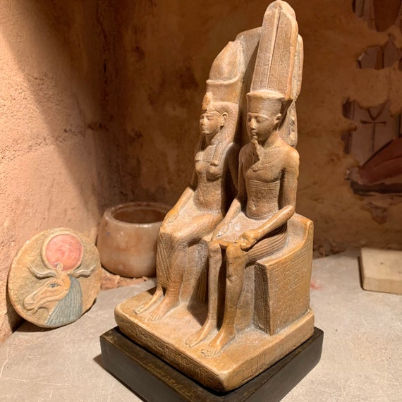 Egyptian museum statue replica of the God Amun & wife Mut. Ancient Egyptian mythology