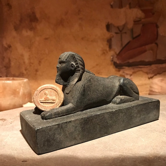 Egyptian Sphinx statue and amulet replica set. Egyptian sculpture and miniature relief