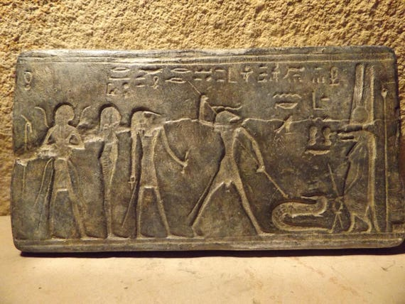 Egyptian mythology relief sculpture featuring Heka, Thoth, Khnum, Taweret, Seth
