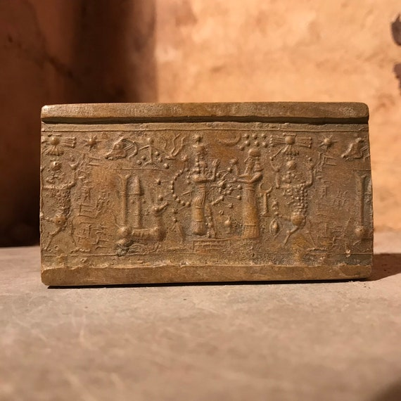 Ishtar - Mesopotamia - Assyrian cylinder seal impression. Astronomical motif