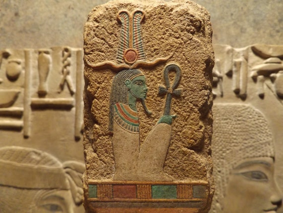 Egyptian art - painted relief sculpture of the God Osiris. Mythology of ancient Egypt. Supreme deity of the afterlife