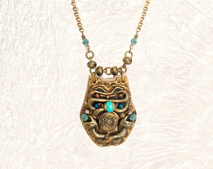 Featured listing image: SHIELD PENDANT : Brass Serpent, Turquoise & Apatite on Metallic Leather