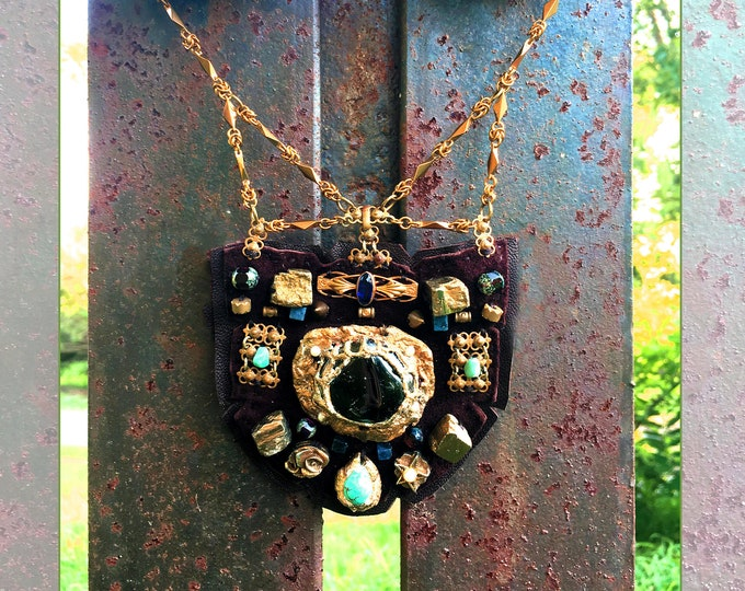 Featured listing image: THE SHIELD NECKLACE by Gilded-Mane : Vintage Brass Jewelry, Pyrite & Turquoise on Chocolate Deerskin Leather