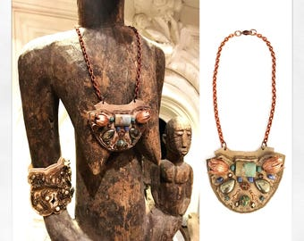 The MINI SHIELD NECKLACE by Gilded-Mane: Rose Gold Brass Tulips, African Turquoise, Pyrite, and Sodalite Beads on Taupe Leather, Small