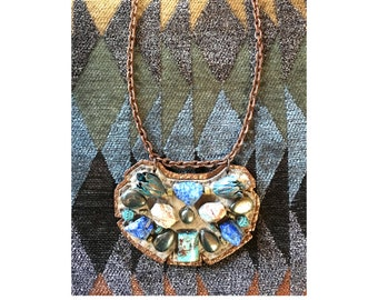 The MINI SHIELD NECKLACE by Gilded-Mane: African Turquoise, Agate & Oxidized Brass Tulips on Taupe/Rose Gold Leather