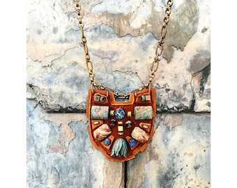 The MINI SHIELD NECKLACE by Gilded-Mane: African Turquoise and Oxidized Brass Beads on Cognac Leather, Small