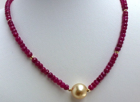 7904d15f73c99 Ruby bead necklace with large golden south sea pearl.
