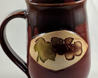 Pottery coffee mug handmade featuring raspberries in a raspberry tone approximately 16 oz