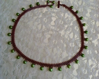 Green freshwater pearl and red beaded necklace