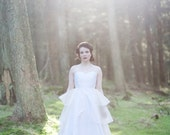 Full skirt, one shoulder wedding gown with layered organza