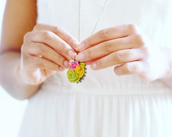 This long 3D flower pendant is made from 100% wool felt and is a summer- autumn favourite necklace because of its mix of colours