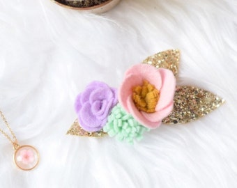 Pastel flower hair clip with gold glitter leaves that is perfect for alternative abd colourful weddings