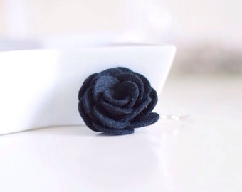 A black flower hair clip for women that is a favourite for wedding guests and women with short hairstyles