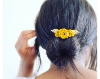 A mustard flower hair accessory that is loved by brides and bridesmaids as a finishing touch to the wedding accessories