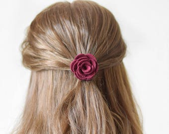 This burgundy felt flower hair clip for women is a favourite finishing touch for autumn and winter wedding and special occassions