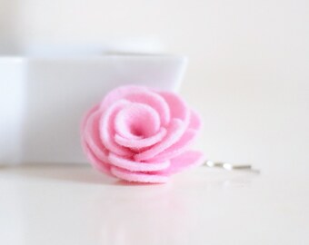 A blushing pink flower hair clip for women that is most loved as a spring hair accessory for bridesmaids and wedding guests