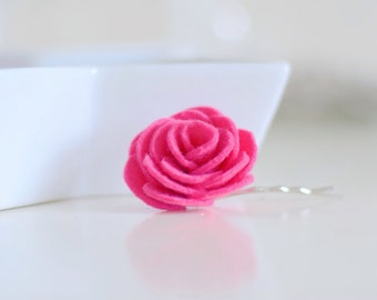 This pink flower bobby pin is a spring -summer favourite for wedding guests, bridesmaids and women with short hair styles