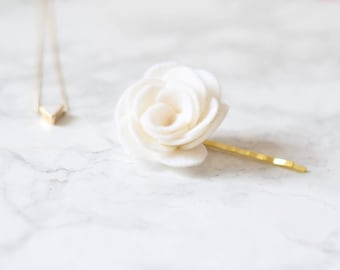 This white flower hair clip for women is a favourite wedding finishing touch for brides and bridesmaids with short hairstyles
