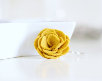 This mustard flower hair clip is loved as a finishing touch by bridesmaids and wedding guests in the summer- autumn wedding season