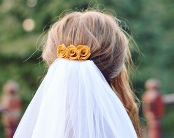 A mustard yellow flower hair comb made for wedding guests, and bridesmaids. Loved by brides for summer and autumn weddings