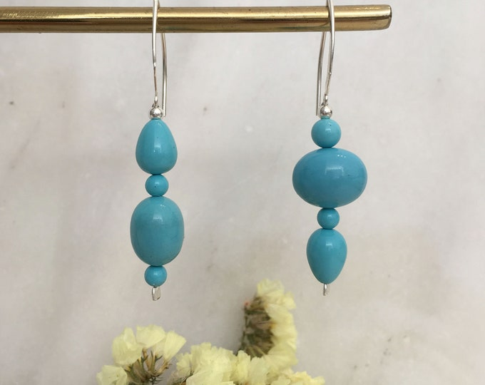 Mismatched turquoise sculptural shell earrings