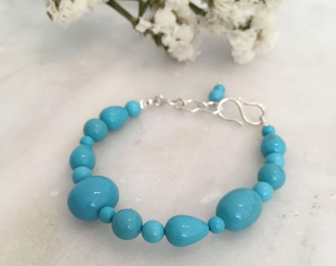 Turquoise sculptural shell bracelet