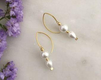 White sculptural shell pearl earrings