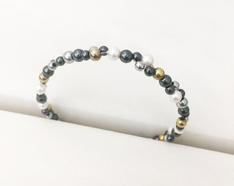 Silver, shell and hematite cluster bracelet
