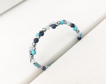 Aquamarine, sodalite, shell and hematite cluster bracelet