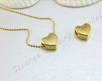 Gold heart pendant etsy heart gold charm 2 pcs gold heart pendant initial gold hearts 24k gold shiny plated hearts gold heart charms gold initial pendants aloadofball Image collections