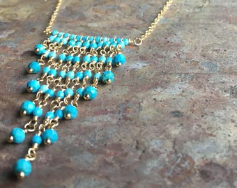 Turquoise gemstone gold tassel necklace