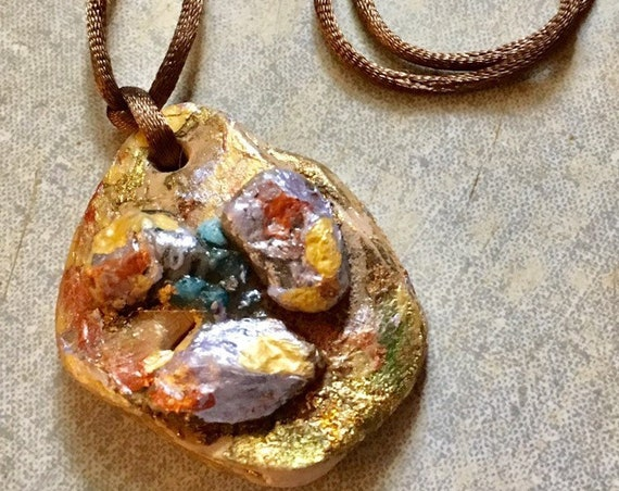 Pendant painted in golden ,light purple .copper and light brown beble with brown satin cord for her