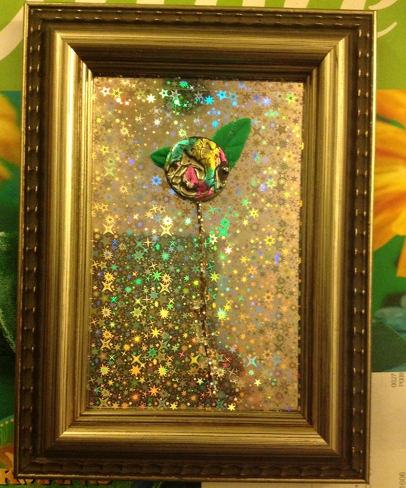 ART ,MIXED MEDIA Miniature floral sculpture,painted button and green leaves hand made clay,framed with holograph paper