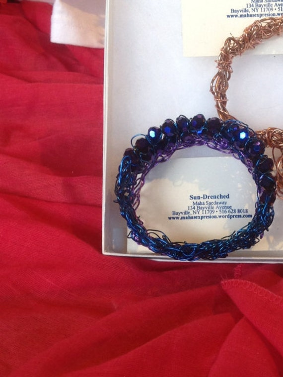 braclet  beaded  with deep  purple blue crystal with purple and blue wire