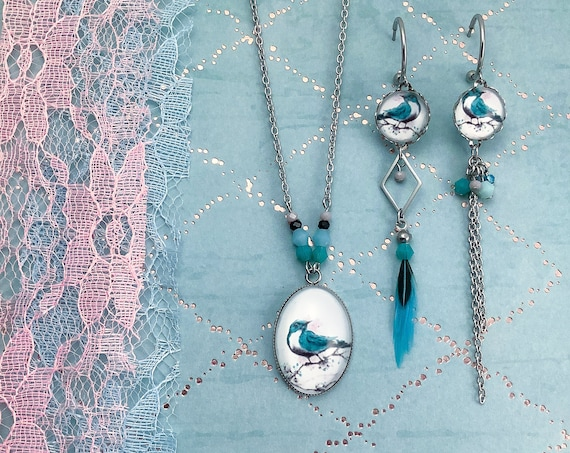 Asymétric feather earings and necklace