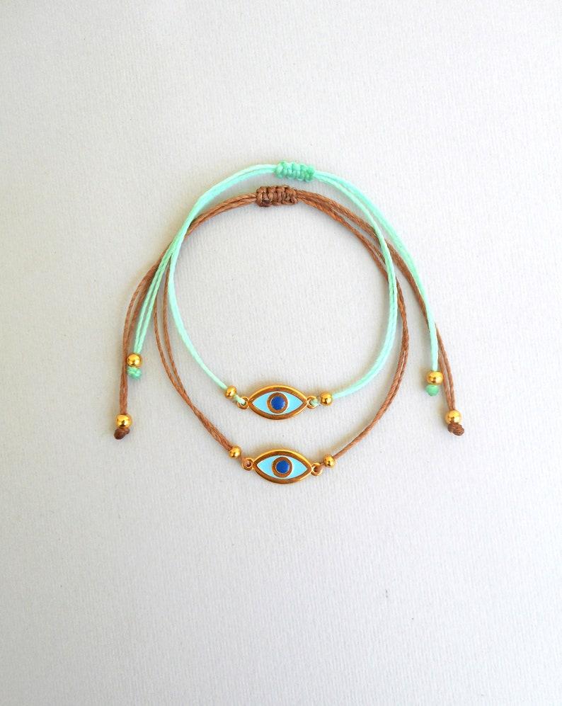 7873b017d9a Martis bracelet Evil eye bracelet Gold enamel charm Waxed | Etsy