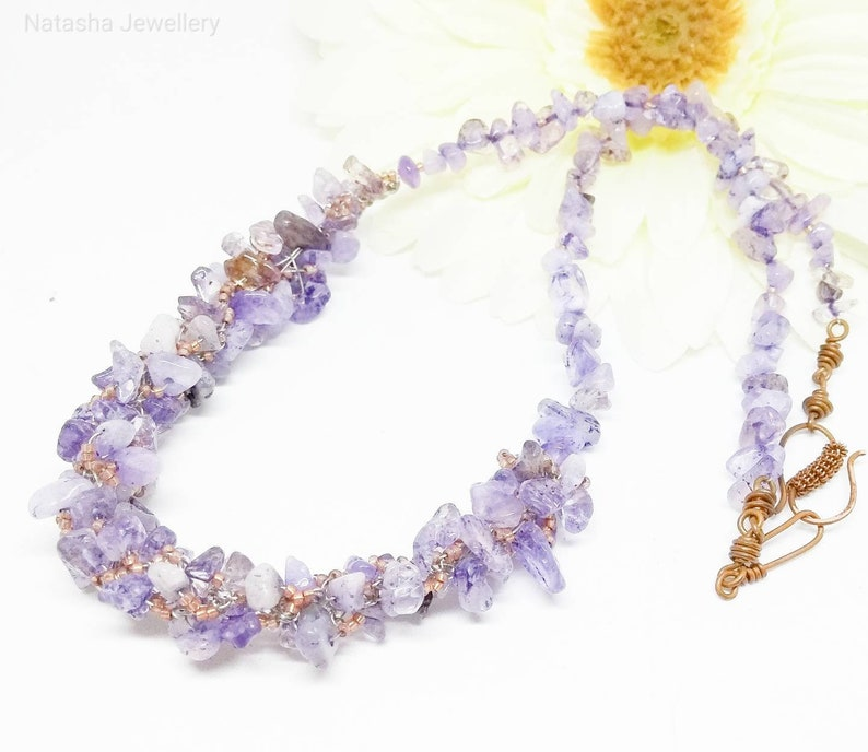 High quality well polished semi transparent stones. Kumihimo necklace with Amethyst chips and glass beads