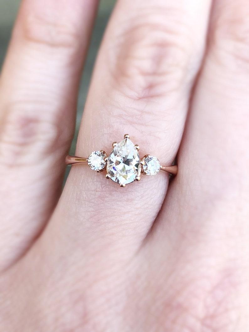 b27792d5ed278 Pear moissanite three stone engagement ring, pear engagement ring, three  stone ring, rose gold moissanite ring, alternative engagement ring