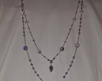 Double strand long necklace with owl charm.