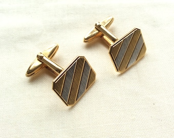 Vintage gold and silver tone tone cufflinks. Made in Germany, hinged backs.