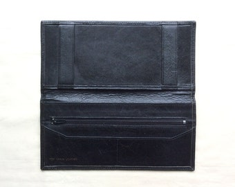 Vintage leather cheque book cover wallet. Black leather with fabric lining.