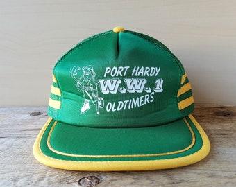 bb6abca5e5d Vintage 80s PORT HARDY W.W.1 OLDTIMERS Hockey Trucker Hat Green Mesh Yellow  3 Stripe Snapback Baseball Cap Retro Young An Ballcap