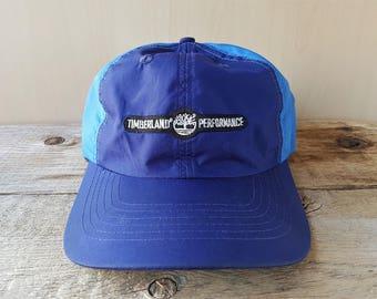 6dbd3678 Vintage TIMBERLAND PERFORMANCE 'Sample' 6 Panel Cap Blue Polyester Original  Strapback Buckle Hat Hiking Outdoors All Weather Promo Ballcap