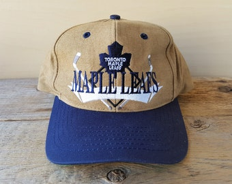 3267ba6f8f5a0a Toronto MAPLE LEAFS Vintage 90s Snapback Hat Official NHL Cap by The Game  Embroidered Hockey Sticks Logo Team Cotton 2 Tone One Size Ballcap