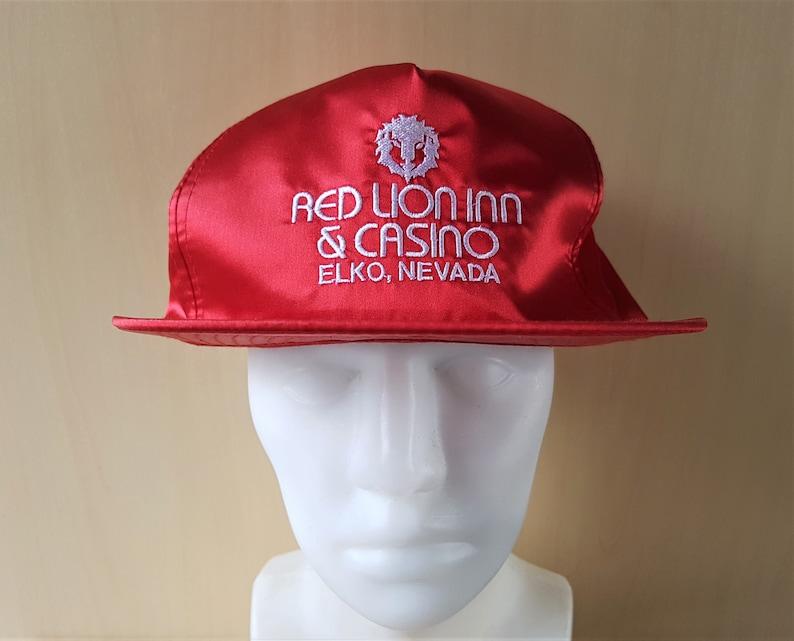 c235549bee0d91 RED LION Inn & Casino Vintage 90s Red Shiny Nylon Zipback Hat   Etsy