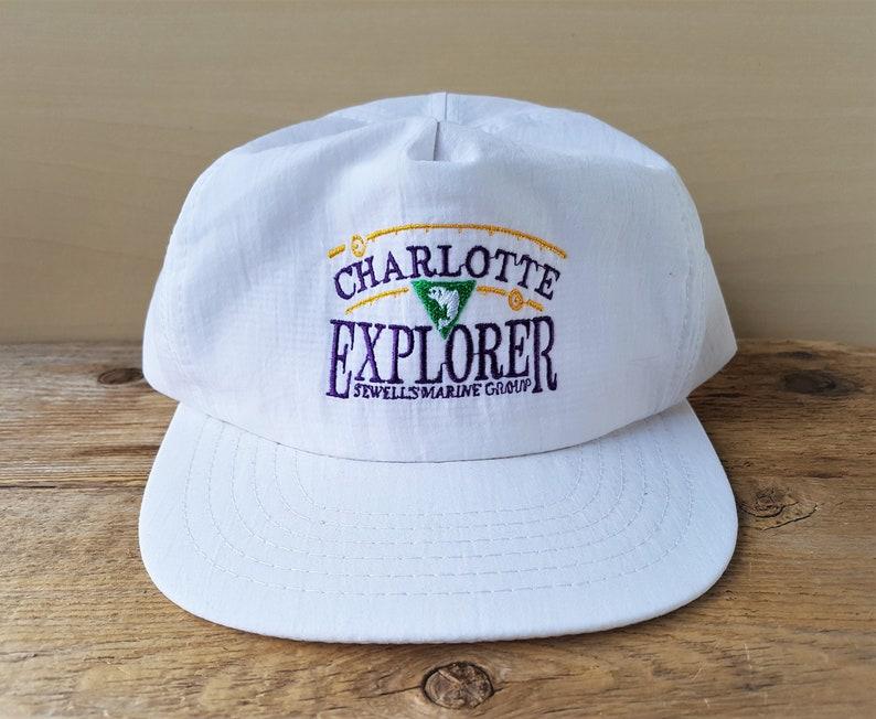 bf7355c283e Vintage 90s CHARLOTTE EXPLORER Snapback Hat Defunct